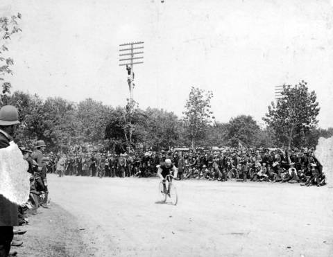 People gather to watch a bicycle race in Chicago's Englewood neighborhood, circa 1897.