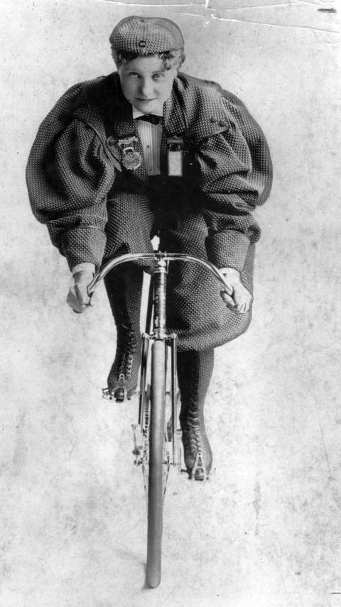"""Tillie Anderson Shoberg wears a costume worn by women cyclists in the early 1890s. Shoberg was known as """"Tillie the Terrible Swede."""" An immigrant from Sweden, Shoberg was known as the best female bicyclist in the late 1800s. She competed until 1902 when the League of American Wheelmen banned women from racing. Undated photo."""