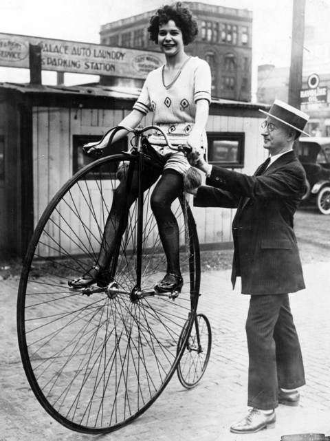 A woman on a Victorian-era bicycle on July 17, 1922, in Chicago.