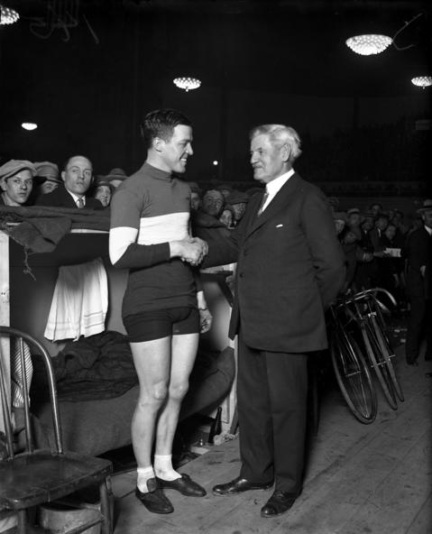 """Chicago Mayor William Dever, right, with racer Carl Stockholm at the six-day bicycle races that started on March 20, 1927, at the Dexter Park Pavilion. """"Carl Stockholm, a Chicago boy and one of the most popular riders in the race, has a good opportunity to win the coming grind,"""" the Tribune reported before the start of a six-day race in 1927. Stockholm and Italian rider Franco Georgetti won the race."""