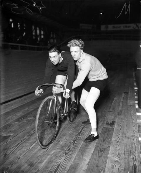 """American teammates Freddie Spencer, left, and Bobby Walthour Jr. competed in the six-day bicycle race at Chicago Coliseum, which started on Jan. 8, 1928. The Tribune called Walthour """"one of the best-known six-day bike racers in the world."""" The American team came in second place."""