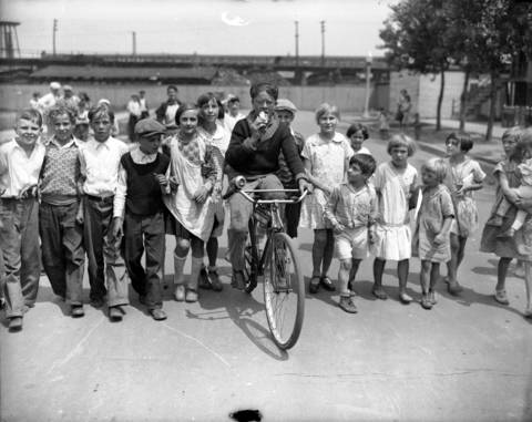 Endurance bicyclists were all the rage in 1930, including Victor Preisinger, 15, of 5009 S. Artesian Ave., who said he would pedal until his bike wears out. The ice cream cone he is eating came as a tribute from one of his fan in 1930.