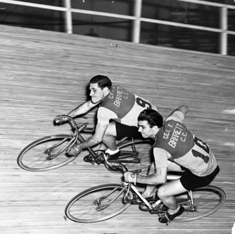 In 1942, the Tribune reported: While their more experienced rivals in the six-day bicycle race at the Chicago Coliseum have been tumbling all over the track this week, Bill Jacoby, left, and Ed Carfagnini, a team of Chicago's youngsters, have maintained their equilibrium through the hardest jams. In this picture, Carfagnini is giving Jacoby a push as the latter takes over for the team. The race will end at midnight on Jan. 30, 1942. Carfagnini, who worked in a Chicago bicycle factory, was a distance racer who won national titles and turned professional in 1941.