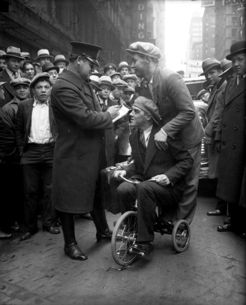 Officer John Berry issues a ticket to American rider Harry Horan, seated, and French rider Marcel Guimbretiere for speeding at Clark and Madison streets on a Liberty Limitedin February 1931.The two bicycle racers were in town for the six-day bike race that started on Feb. 8, 1931, at the Chicago Stadium.