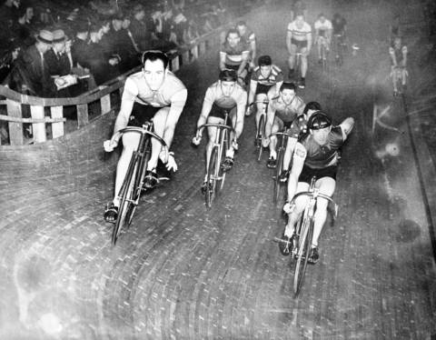 Heinz Vopel, left, of Dortmund, Germany, and Gerard Debaets, of Belgium, ride in front of the field, which started a six-day race at the Chicago Stadium on Feb. 12, 1939. Two weeks before, Vopel fractured his left wrist during a race in Cleveland. A dozen teams started the six-day race.