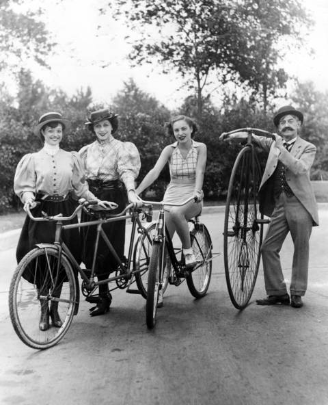 Fannie Ellen, from left, Lillian Dushell, Anita Conier and Guy Hickman with old-fashioned bikes in Lincoln Park in1936.
