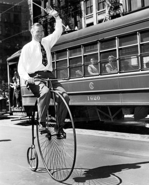 A man rides a Victorian-era bicycle in Chicago in 1947.