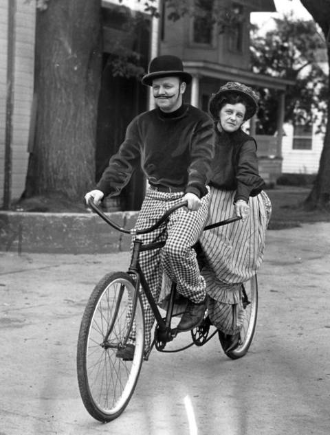 Mr. and Mrs. Wilbur Fredrick, of Huntley, Ill., on a tandem bike they rode in the town's Centennial Parade the day before in1951.