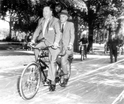 Marking the opening of the first of a series of cycling trails in 15 parks, Mayor Richard J. Daley, left, and Dr. Paul Dudley White, a heart specialist who attended to President Dwight D. Eisenhower, ride a tandem bike in Ogden Park on June 2, 1956. Designed to promote safety, rules require single-file riding, ban speeding and racing and require cyclists to dismount when crossing streets and roadways.