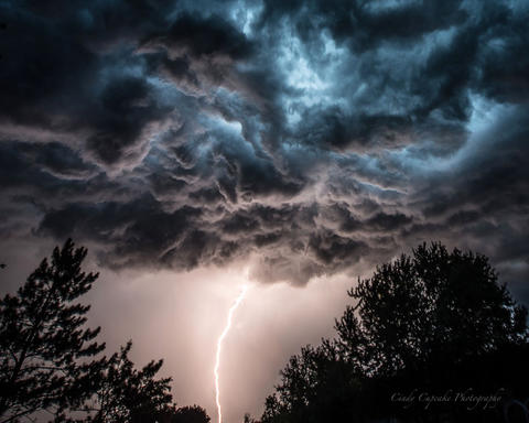 My name is Cindy Bean of Cindy Cupcake Photography (My Facebook photography Page) This photo was taken from my back deck in Lakes of the Four Seasons (Crown Point), Indiana on the evening of 07/24/2016 during an approaching storm.