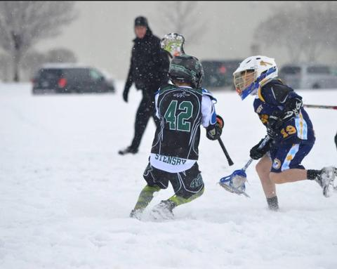 Chase Stensby of Naperville on the attack in a Lacrosse game in South Bend, IN... Normal? Not in 5 inches of snow... Brrrrr!
