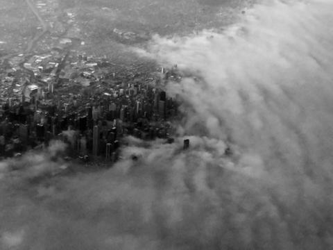 Lake Michigan fog encroaches the City...from my flight on 3/14. Dennis Gallitano