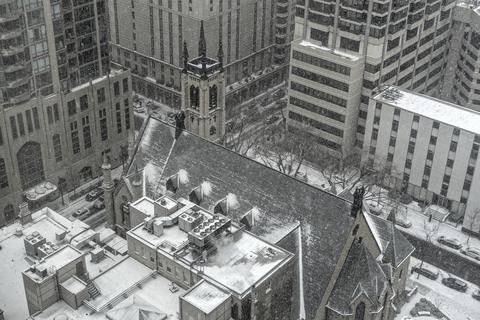 A look from my bedroom window on Valentine's Day shows a lovely rooftop view of St. James Catherdral in the snow.