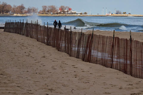 braving the cold to walk the dog at Oak Street beach