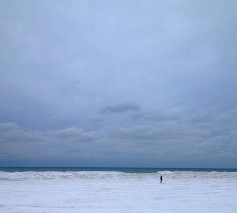 One intrepid person braving the cold to walk their dog (out of frame) on Montrose Beach