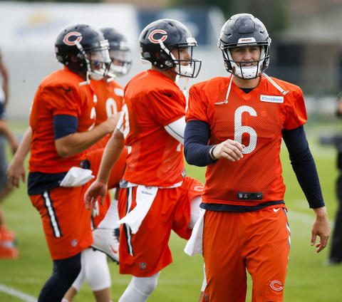 Jay Cutler and the quarterbacks during warm-ups on the first day of training camp at Olivet Nazarene University in Bourbonnais on July 28, 2016.