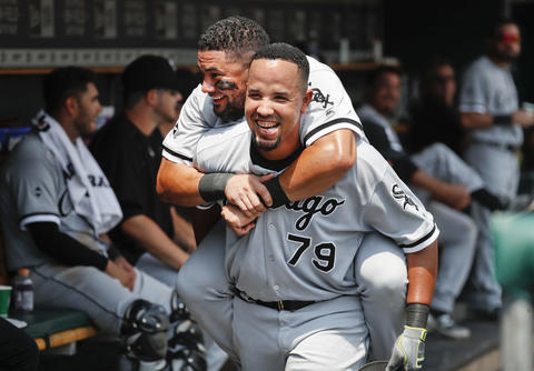 Jose Abreu celebrates his two-run home run as Melky Cabrera rides on his back in the dugout against the Tigers in the second inning on Aug. 4, 2016.
