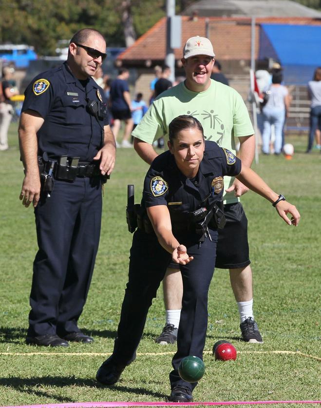 November 7, 2015_San Diego, California_USA_| At Rancho Bernardo Recreation  Park San Diego Police Officer Jacki Lowry Rolls A Bocce Ball During Bocce  Ball ...