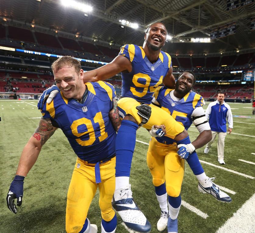 Robert Quinn, Chris Long and William Hayes accepted the