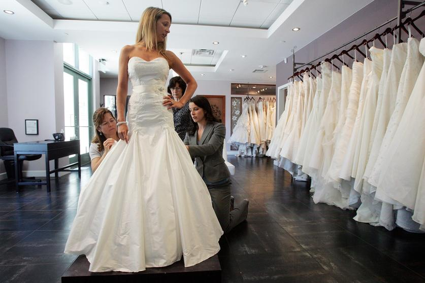 Cost conscious couples say i dont to some wedding frills the store owner courtney cole right works with clients at the white flower bridal boutique on wednesday in san diego california eduardo contreras u t mightylinksfo