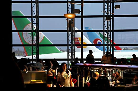 International travelers to the U.S. spent $3.5 billion on airfares in January, according to the federal government.