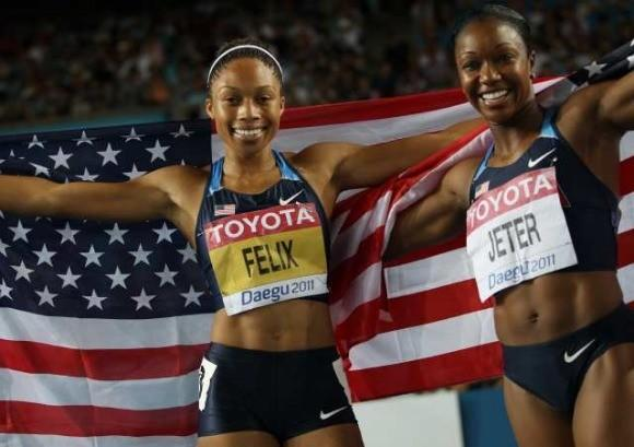 Bronze medalist Allyson Felix and silver medalist Carmelita Jeter after the 200.  (Adrian Dennis / Getty Images)