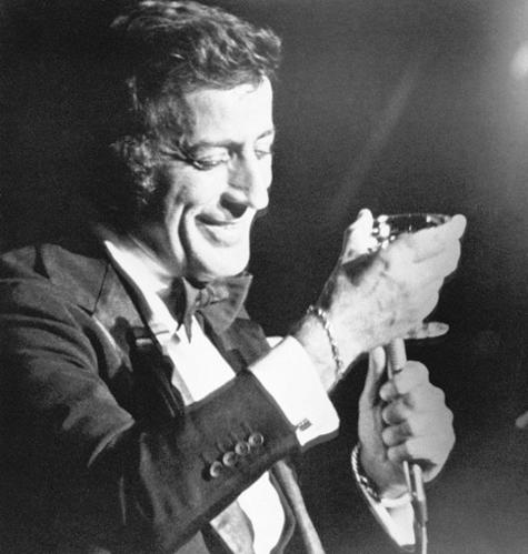 """Tony Bennett toasts his audience with Champagne during a engagement in 1977 at the hotel Sahara on the Las Vegas strip.<br> <br> <a href=""""http://projects.latimes.com/hollywood/star-walk/tony-bennett/""""><span class=""""center_label"""">Tony Bennett: Hollywood Star Walk</span></a>"""