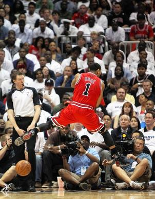 Derrick Rose tries to save a ball from going out of bounds in the second half.