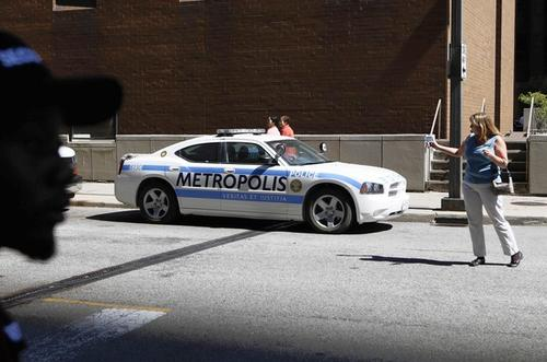 """A """"Metropolis"""" police car is parked on Lake and Stetson near where portions of the film """"Man of Steel"""" are being shot."""