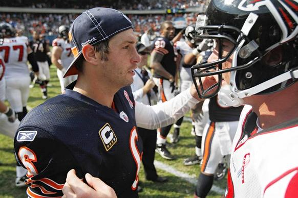 Bears quarterback Jay Cutler meets Falcons quarterback Matt Ryan after the game.
