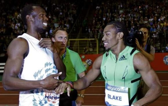 Usain Bolt (l) congratulates Yohan Blake after Blake's stunning race Friday in Brussels.  (Francois Lenoir / Reuters)
