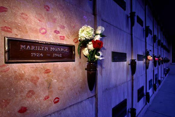 "<a class=""taxInlineTagLink"" id=""PECLB003245"" title=""Marilyn Monroe"" href=""/topic/entertainment/marilyn-monroe-PECLB003245.topic"">Marilyn Monroe</a> rests in a crypt (her name surrounded by lipstick kisses) near the northern corner of the Pierce Bros. Westwood Village Memorial Park and Mortuary. The property is a grassy territory covering barely two acres."