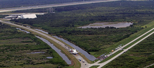 Space shuttle Atlantis,STS-135, is towed to a Oribitor Processing Facility at Kennedy Space Center after landing concluding 30 years and 135 missions.