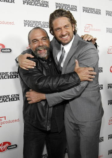 Sam Childers with 'Machine Gun Preacher' star Gerard Butler