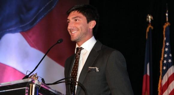 "Evan Lysacek telling U.S. Olympic Assembly dinner, ""My sights are on Sochi"" (Courtesy U.S. Olympic Committee)"