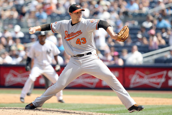 Orioles reliever Jim Johnson pitches in the sixth inning of the team's 4-2 loss to the host Yankees. Johnson threw two scoreless innings, allowing two hits while striking out three.