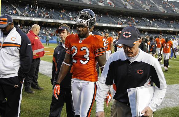Devin Hester walks off the field after his team's 27-17 loss to the Packers.