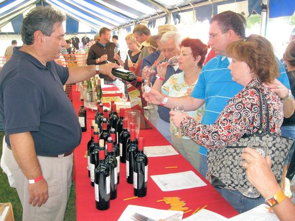 Wine-tastings happen at the Yorktown Wine Festival