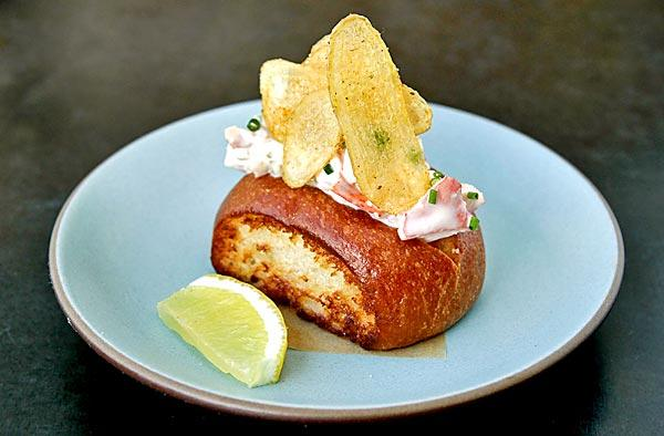 At Son of a Gun, the fresh meat in the lobster roll is dressed with celery and lemon aioli.