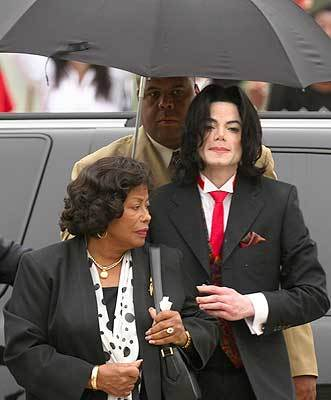 Michael Jackson arrives at the Santa Barbara County courthouse with his mother, Katherine, in May 2005, during his trial on child-molestation charges.