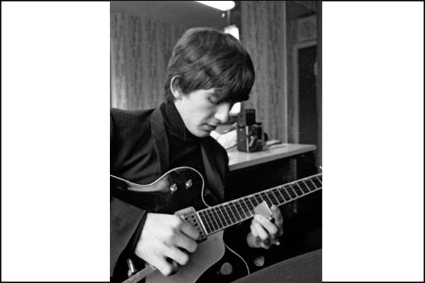"<a class=""taxInlineTagLink"" id=""PECLB002237"" title=""George Harrison"" href=""/topic/entertainment/music/george-harrison-PECLB002237.topic"">George Harrison</a> rehearses in the mid-1960s."