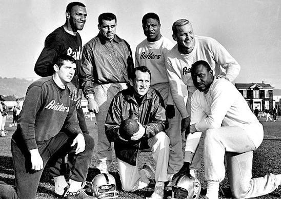 Oakland coach and general manager Al Davis, holding football, joins Raiders players named to the Associated Press 1963 American Football League All-Star team. From left are defensive halfbacks Tommy Morrow and Fred Williamson, linebacker Archie Matso