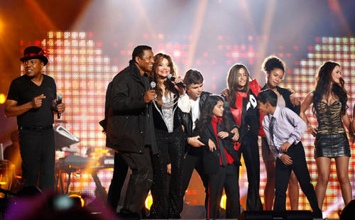 Tito Jackson (L) and LaToya Jackson (3rd L), siblings of the late pop star Michael Jackson, his children Prince Michael Joseph Jackson Jr. (4th L), Prince Michael Jackson II (Blanket) and Paris-Michael Katherine Jackson (3rd R) perform on stage during the 'Michael Forever' tribute concert.