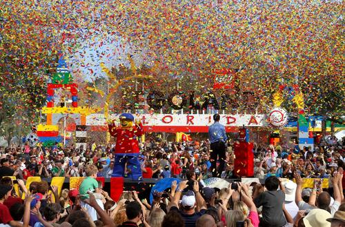 The confetti flies over the entrance to Legoland Florida as thousands pack the entrance for the 10am grand opening ceremony, in Winter Haven, Fla., Saturday, October 15, 2011.