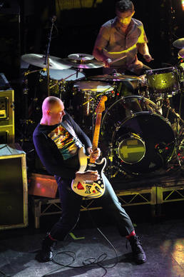 Smashing Pumpkins, including Billy Corgan  and drummer Mike Byrne, perform at the Riviera Theatre in Chicago on Friday, October 14, 2011.
