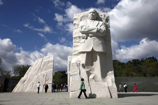 "A visitor walks through the <a class=""taxInlineTagLink"" id=""PEHST001228"" title=""Martin Luther King Jr."" href=""/topic/arts-culture/culture/martin-luther-king-jr.-PEHST001228.topic"">Martin Luther King Jr.</a> Memorial in Washington earlier this month. The original dedication was set for Aug. 28 but was postponed because of <a class=""taxInlineTagLink"" id=""EVWAN00009"" title=""Hurricane Irene (2011)"" href=""/topic/disasters-accidents/meteorological-disasters/hurricane-irene-%282011%29-EVWAN00009.topic"">Hurricane Irene</a>."