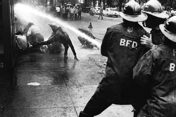 "Firefighters in Birmingham, Ala., turn their hoses on civil rights activists. <a class=""taxInlineTagLink"" id=""PEHST001228"" title=""Martin Luther King Jr."" href=""/topic/arts-culture/culture/martin-luther-king-jr.-PEHST001228.topic"">Martin Luther King Jr.</a>'s civil rights campaign drew nationwide attention in the Southern city in the spring of 1963. King was jailed during the demonstrations, along with many supporters.  From Birmingham jail, King wrote a letter explaining his stand on nonviolent protests:  ""You may well ask,"" he wrote, ""'Why direct action? Why sit-ins, marches and so forth? Isn't negotiation a better path?' You are quite right in calling for negotiation. Indeed, this is the very purpose of direct action. Nonviolent direct action seeks to create such a crisis and foster such a tension that a community which has constantly refused to negotiate is forced to confront the issue."""