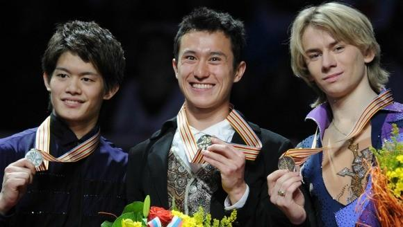 Winner Patrick Chan surrounded by silver medalist Takahiko Kozuka of Japan (l) and bronze medalist Artur Gachinski of Russia at 2011 worlds. (Oleg Nikishin / Getty Images)
