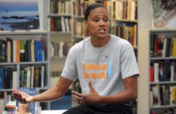 Marion Jones speaking Thursday at a public library in Zagreb, Croatia.  (Nicola Solic / Reuters)