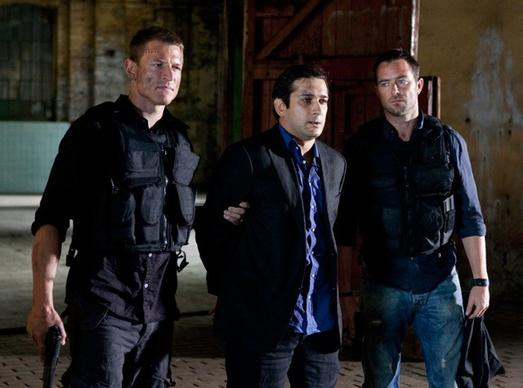 Stonebridge (Philip Winchester) and Scott (Sulivan Stapleton, right) bring Latif (Jimi Mistry) in after months of searching for him.